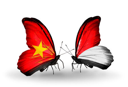 Two butterflies with flags on wings as symbol of relations Vietnam and Monaco, Indonesia photo