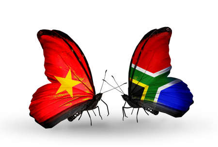Two butterflies with flags on wings as symbol of relations Vietnam and South Africa photo