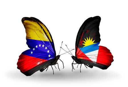 Two butterflies with flags on wings as symbol of relations Venezuela and  Antigua and Barbuda photo