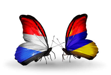 Two butterflies with flags on wings as symbol of relations Luxembourg and Armenia photo