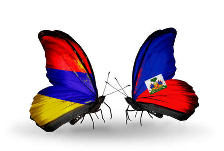 Two butterflies with flags on wings as symbol of relations Armenia and  Haiti photo