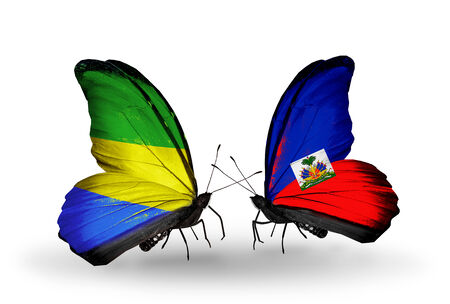 Two butterflies with flags on wings as symbol of relations  Gabon and  Haiti photo