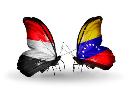 Two butterflies with flags on wings as symbol of relations   Yemen and  Venezuela photo