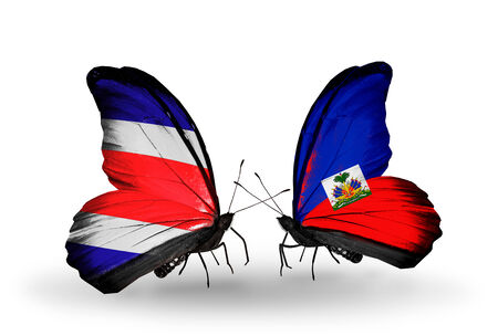 Two butterflies with flags on wings as symbol of relations Costa Rica and Haiti photo