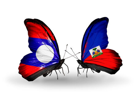 Two butterflies with flags on wings as symbol of relations  Laos and Haiti photo