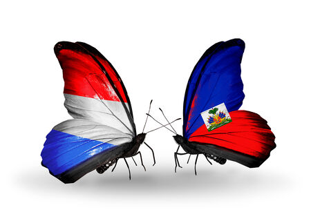 Two butterflies with flags on wings as symbol of relations Luxembourg and Haiti photo