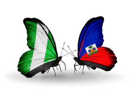 Two butterflies with flags on wings as symbol of relations Nigeria and Haiti photo