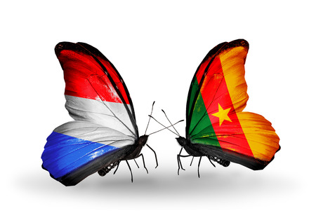 Two butterflies with flags on wings as symbol of relations Luxembourg and Cameroon photo