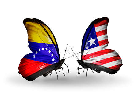 Two butterflies with flags on wings as symbol of relations Venezuela and Liberia photo