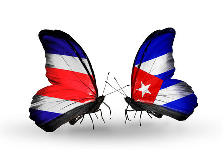 Two butterflies with flags on wings as symbol of relations Costa Rica and Cuba