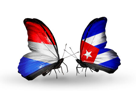 Two butterflies with flags on wings as symbol of relations Luxembourg and  Cuba