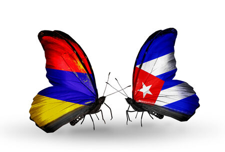 Two butterflies with flags on wings as symbol of relations Armenia and  Cuba