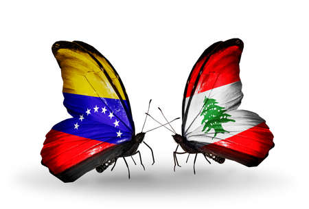 Two butterflies with flags on wings as symbol of relations Venezuela and  Lebanon photo