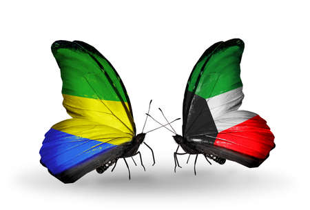 Two butterflies with flags on wings as symbol of relations Gabon and Kuwait photo