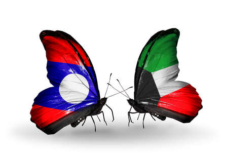 Two butterflies with flags on wings as symbol of relations Laos and Kuwait photo