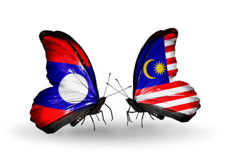 Two butterflies with flags on wings as symbol of relations Laos and Malaysia photo