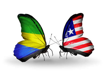 Two butterflies with flags on wings as symbol of relations Gabon and Liberia photo