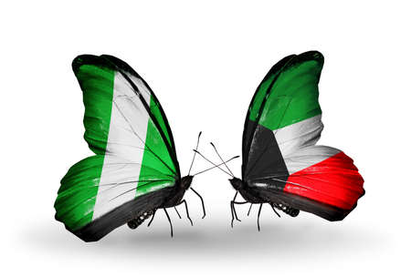 Two butterflies with flags on wings as symbol of relations Nigeria and  Kuwait photo