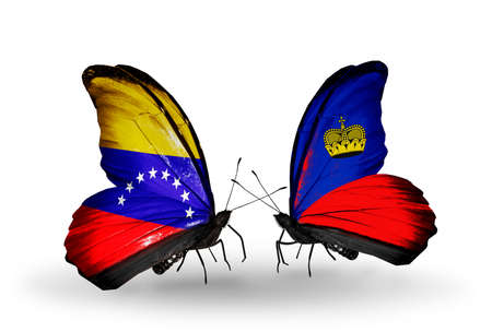 Two butterflies with flags on wings as symbol of relations Venezuela and Liechtenstein photo