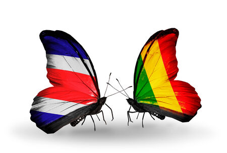 Two butterflies with flags on wings as symbol of relations Costa Rica and Mali photo