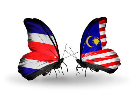 Two butterflies with flags on wings as symbol of relations Costa Rica and Malaysia photo