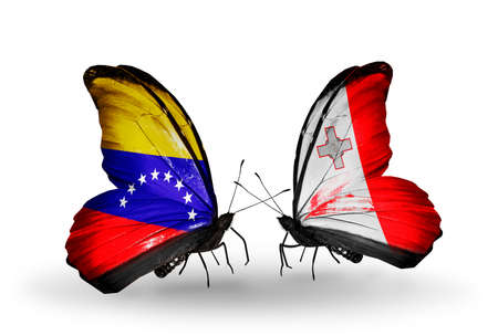 Two butterflies with flags on wings as symbol of relations Venezuela and Malta photo