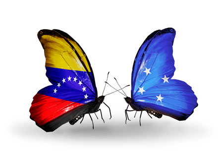 Two butterflies with flags on wings as symbol of relations Venezuela and Micronesia photo