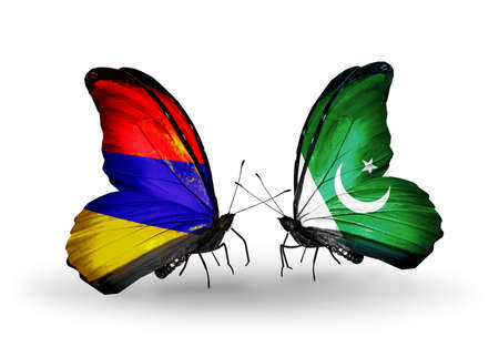Two butterflies with flags on wings as symbol of relations Armenia and  Pakistan photo