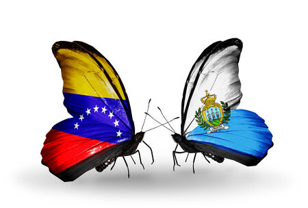 Two butterflies with flags on wings as symbol of relations Venezuela and San Marino photo
