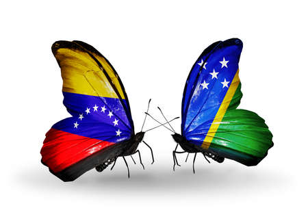 Two butterflies with flags on wings as symbol of relations Venezuela and Solomon Islands photo