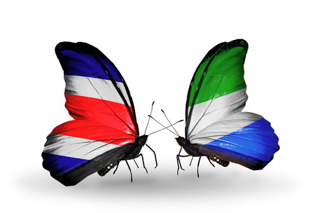 Two butterflies with flags on wings as symbol of relations Costa Rica and  Sierra Leone photo