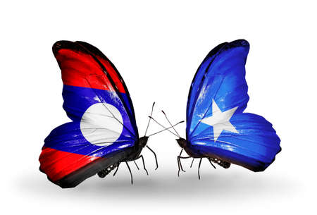 Two butterflies with flags on wings as symbol of relations Laos and Somalia photo
