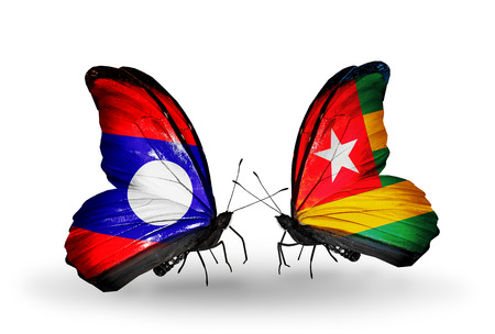 Two butterflies with flags on wings as symbol of relations Laos and  Togo photo