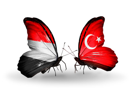 Two butterflies with flags on wings as symbol of relations   Yemen and Turkey photo