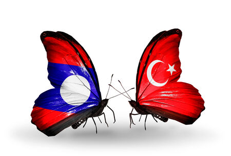 Two butterflies with flags on wings as symbol of relations Laos and Turkey photo