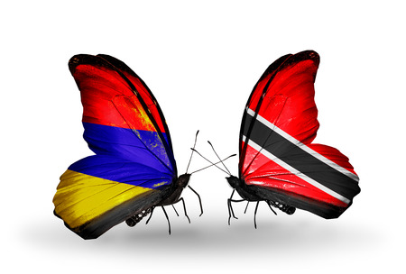 Two butterflies with flags on wings as symbol of relations Armenia and  Trinidad and Tobago photo