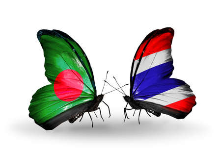 Two butterflies with flags on wings as symbol of relations Bangladesh and Thailand photo
