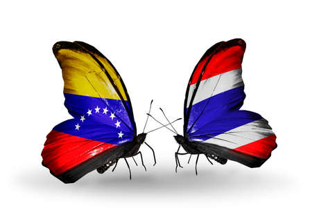 Two butterflies with flags on wings as symbol of relations Venezuela and  Thailand photo