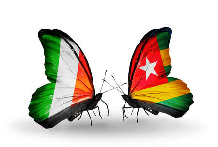 Two butterflies with flags on wings as symbol of relations Ireland and  Togo photo