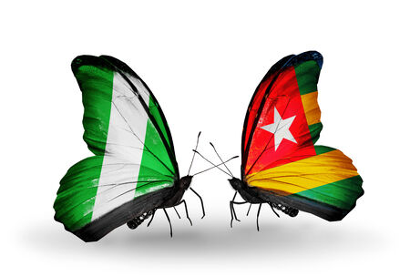 Two butterflies with flags on wings as symbol of relations Nigeria and Togo photo