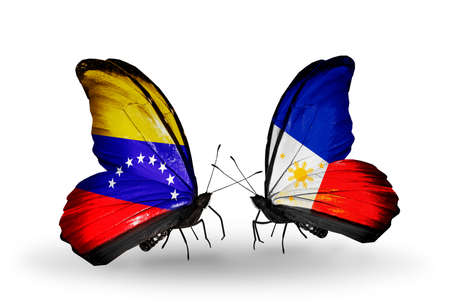 Two butterflies with flags on wings as symbol of relations Venezuela and Philippines photo