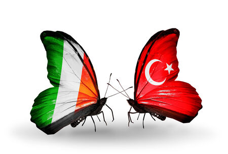 Two butterflies with flags on wings as symbol of relations Ireland and  Turkey photo