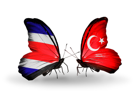 Two butterflies with flags on wings as symbol of relations Costa Rica and  Turkey photo