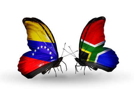 Two butterflies with flags on wings as symbol of relations Venezuela and South Africa photo