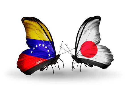 Two butterflies with flags on wings as symbol of relations Venezuela and Japan photo