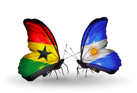 Two butterflies with flags on wings as symbol of relations Ghana and Argentina photo