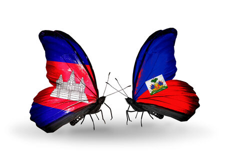 Two butterflies with flags on wings as symbol of relations  Cambodia and  Haiti photo