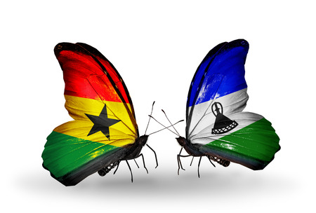 Two butterflies with flags on wings as symbol of relations Ghana and Lesotho photo