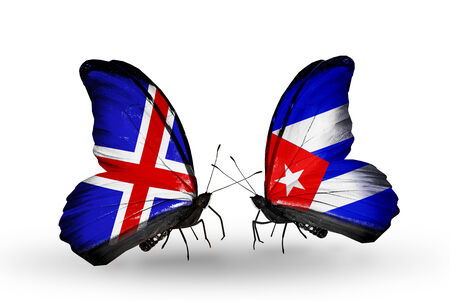 Two butterflies with flags on wings as symbol of relations   Iceland and Cuba Stock Photo