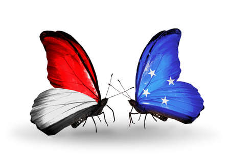 Two butterflies with flags on wings as symbol of relations Monaco, Indonesia and Micronesia photo